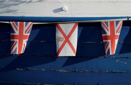 Флаги Великобритании и острова Джерси.