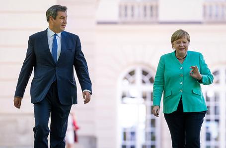 Маркус Зедер и Ангела Меркель.