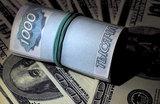 Минфин резко повысил заложенный в проекте бюджета курс доллара