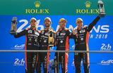 Экипаж российской команды G-Drive Racing в составе Романа Русинова, французов Жан-Эрика Верня и Андреа Пиццитолы, выигравший гонку «24 часа Ле-Мана» в классе LMP2.
