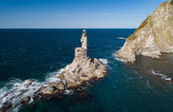 Заброшенный маяк на мысе Анива в Охотском море. Остров Сахалин.